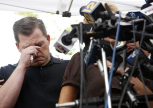 Daniel Schuler cries at a press conference in Garden City (WPIX)