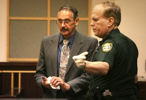 John William Moyer, 60, of Cressona, Penn., left, wipes the ink from his hands after he was convicted and sentenced Tuesday of misdemeanor battery charge for groping of a woman playing Minnie Mouse at Walt Disney World. (GEORGE SKENE, ORLANDO SENTINEL / August 11, 2009)